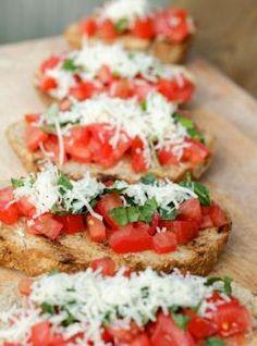 Classic Bruschetta-chopped tomatoes, fresh herbs, cheese and a drizzle of olive oil. Mmmmm.