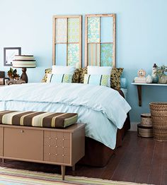 Two single window panels are the perfect alternative to an ordinary headboard. You need two windows that measure approximately the width of your mattress. Remove the glass and install fiberboard or thin plywood over the back for safety. Cut fabric to fit each section and secure it in place with spray adhesive.