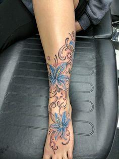 lily tattoo, lilies, foot ankle tattoo, stars, leg calf tattoos