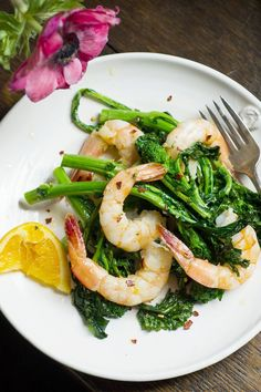NYT Cooking: This dish uses one of my favorite techniques for cooking just about anything quickly: high-heat roasting. All you do is spread seasoned protein and vegetables out on one rimmed baking sheet and roast everything at the same time. Here I've paired shrimp with broccoli rabe, which cook in about 10 minutes flat.