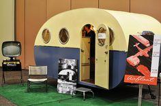 The Airfloat camper trailer. Love those portal windows!