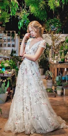 37837c1c8572a floral wedding dresses a line lace v neckline with short sleeves savin  london #weddingdressesshoppingtips Boho