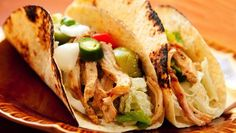 Chicken, taco seasonings and some salsa make for some tasty shredded chicken in the slow cooker.