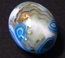 Polymer clay bead with composition leaf and translucent clay