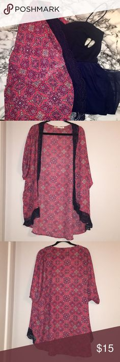 Red & Navy Patterned Kimono This is a reddish pink colored kimono/cover up with a paisley style pattern throughout. There are navy and white accents and a lace navy trim on the outside. It's light weight and has only been worn a handful of times and is a sheer material.  *dress and earrings not included, just for styling* Liberty Love Sweaters Cardigans