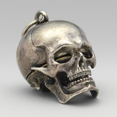Watch in the form of a skull, circa Movement by Isaac Penard (Swiss, Case and dial: silver, partly nielloed, with a single silver hand; Movement: gilded brass and steel;) Metropolitan Art Museum of Art Memento Mori, Skull Jewelry, Antique Jewelry, Jewellery, Skull Necklace, Sculpture, Skull And Bones, Skull Art, Metal Skull