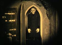 "Nosferatu (1922) - Vampire Count Orlok expresses interest in a new residence and real estate agent Hutter's wife. Silent classic based on the story ""Dracula."""