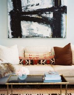 Bold art, love the long pillow, subtle nod to Ethnic.