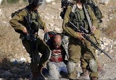 Israeli forces maltreat a Palestinian civilian near al-Jalazoun refugee camp.
