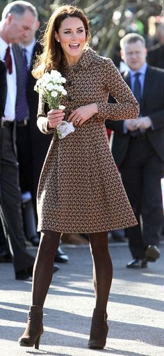 Another fabulous dress coat on Kate.  Doubt it would look half this good on me!
