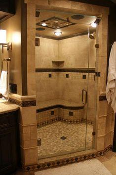 Happy Customer! Travertine shower with river rock shower floors.