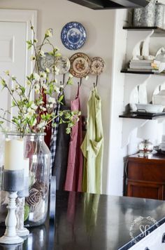 Great idea for wall hooks...look at the back wall - hooks combined with a few of your favorite plates.