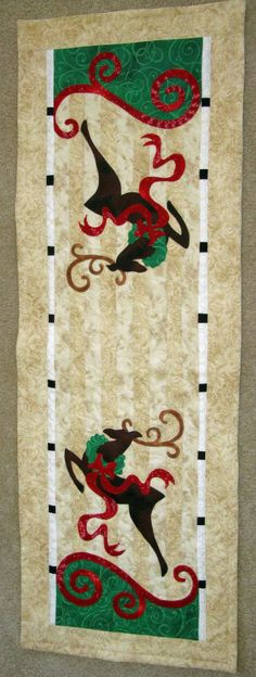 Christmas table runner made by Janet Beyea maybe with blue snowflake or star background fabric would be better