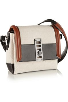 Beige canvas, brown and black leather (Calf) Twist lock-fastening front flap Comes with dust bag Weighs approximately 1.5lbs/ 0.7kg