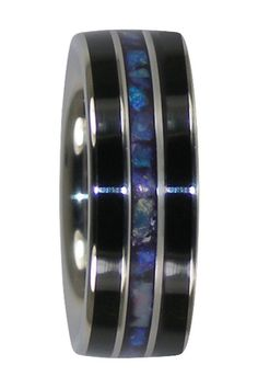This is a Titanium Ring with Black Jet Gemstone (petrified wood) and Lightning Ridge Blue Opal Inlay. Includes a high polish design and Comfort Fit. Carries a lifetime warranty.