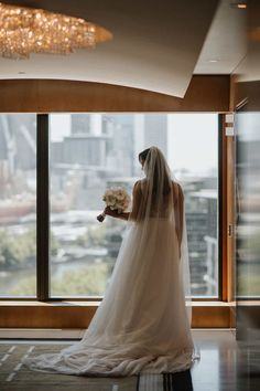Zina in Crown Towers Melbourne, moments before her wedding ceremony at the Crown Aviary rooftop marquee. #weddingvenue #melbournewedding #realweddings