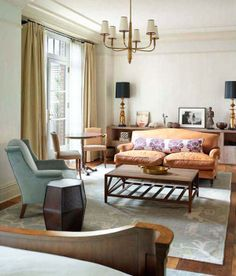 Easy, laid-back style; love the lumbar pillow on couch, and lamps on console on far wall
