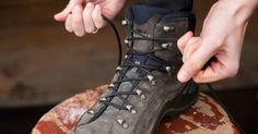 REI Expert Advice: How to Lace Hiking Boots - detail of a hiker tying the laces on their hiking boots