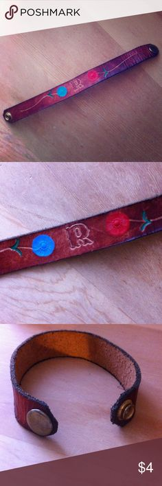 """Flowered 'R' Bracelet Unique bracelet monogrammed with a single 'R' with red and blue flowers. Possibly real leather but not 100% sure. Bought on a roadtrip somewhere in the midwest at a mom & pop store. Really cute but never worn it. Thought it was time to let it go. : ) 8"""" long, 3/4"""" wide. Jewelry Bracelets"""