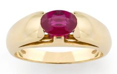 A ruby dress ring, by Bulgari Designed as an oval-cut ruby, set within a tapering polished mount, signed Bulgari, ruby weighs approximately 1.01 carats, mounted in 18 carat yellow gold, with maker's case