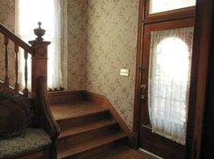 Love the everything about it - the door, the landing, the banister;  look at the push-button light switches!