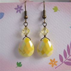 Yellow teardrop earrings.   Made with AB yellow acrylic faceted teardrop beads and Swarovski bicone crystals, antiqued brass craft wire and finished with antiqued brass ear wires.   Earrings approx 1.75 (4.3cm) long including ear wire.    Your package will be shipped by Registered Mail with tracking number and signature confirmation.   Thank you for visiting Little Pink Box!
