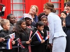 The Duchess shares a laugh with the children who had gathered outside an art gallery in The Hague to welcome the royal visitor
