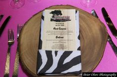 These Bat Mitzvah menu cards were printed on paper that looked like wood to match the zebra/safari theme. | MitzvahMarket.com