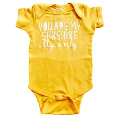 You are My Sunshine My Only Screen Printed on Gold Baby Onesie Great Shower Gift, First Birthday Gift Or Party Favor, White Blue Yellow Gold. $16.00, via Etsy.
