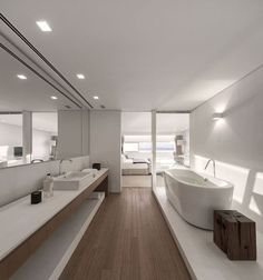 Urca Apartment / Studio Arthur Casas A wood floor could look really cool in the master bathroom.....