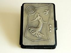Kindle Case / Cover with a Pewter Embossed Dancing Lady   This image is available for various Kindle models. A super gift for a lady.