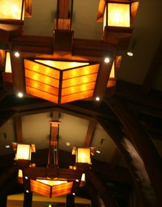 The Grand Californian's arresting chandeliers top a soaring arched-tree-trunk structure modeled after A. Page Brown and Bernard Maybeck's Swedenborgian Church in San Francisco.
