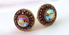 Pair of garnet red rhinestone earrings with ABs in round antique gold and vintage:  Fabulous pair of rainbow aurora borealis rhinestone clip earrings that are bezel set a... #glitter