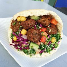 We have DIY pitas so it's up to you how you fill yours - and boy are we stuffed! by falafelhut