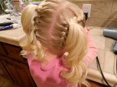 Upside down French braided Piggies, cute girls hairstyle....i know this is for little girls but i kinda love it