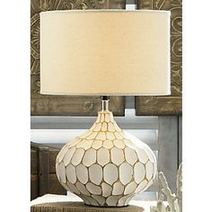 Saw a lamp very similar to this at Home Goods. I think every home accent piece we have is from there. Love it!