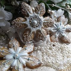 Gingerbread keepsake snowflakes Christmas gingerbread cookies, intricately hand piped and dry brushed with luster dust.