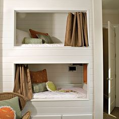 bunk bed cubbies with mounted tv.