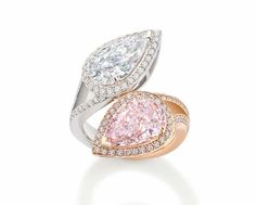 @boodlesuk Gemini ring with a natural light pink diamond, mirrored by a D colour white diamond. #pink #diamonds #boodles