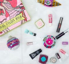 Girl-o-clock rock set in a colorful winter scene with gifts around festive ornaments. set includes: the POREfessional mini Christmas Gift Guide, Christmas Countdown, Makeup Advent Calendar, Advent Calendars, Whats In My Makeup Bag, Rock Festivals, Benefit Cosmetics, Winter Colors, Oclock