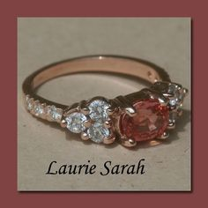 Usually I prefer white gold, but there is just something about the padparadscha sapphire set in the rose gold.