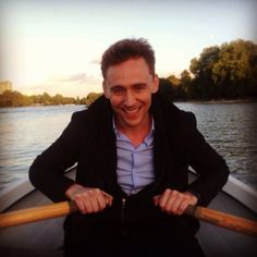 The sun sets slowly over the lake. It's warm light flickers, lingering over London which seems dim compared to his glowing smile. He rows gently, the button on his shirt straining, not disagreeably, with his movements. You lean back in the small boat, soaking in the scenery and smile. He leans closer. Cinnamon and Pine waft through the air, yet closer he moves.