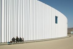 Warehouse,Germany by SANAA Corrugated acrylic panels wrap a concrete wall