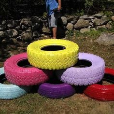 Repurposed tires , spray painted and turned into planters
