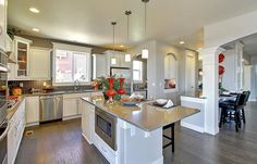 Microwave under the counter. Spacious kitchen design inspiration. Design by #DRHorton #Homes