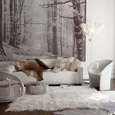 Warm living room  Nature-inspired artwork makes a stunning backdrop to this white living room. Sleek, modern furniture is softened with sheepskin accessories and a luxurious rug.