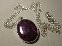one of my first attempts at pouring into a bezel. This oval pendant was created to match a bracelet using a colour blend from purple through to a rich red. By adding a small amount of transparent I have created a more translucent feel than just straight purple and not totally mixing allows the swirling which is a real feature