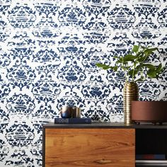 Shop damask white and navy wallpaper. Popular in European drawing rooms way back in the day, designers Hygge and West gave this traditional pattern an unfussy twist. Designed exclusively for CB2, floral flourishes are almost scraped away in places for a modern distressed effect.