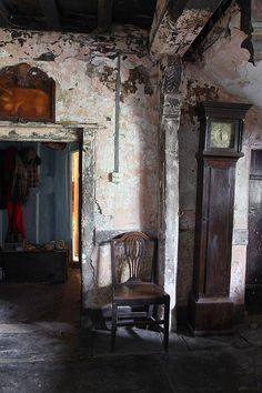 '16thC Welsh farmhouse, antique grandfather clock' - love the clock!