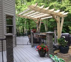 Cantilevered pergola that my husband designed and built over a portion of our deck. Materials list and photos on blog post at source.